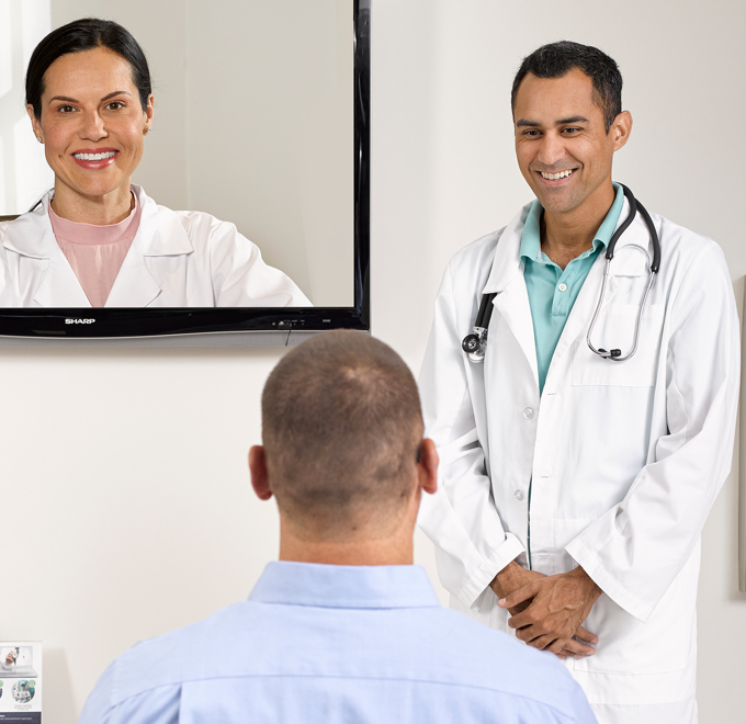 Two doctors talking to patient